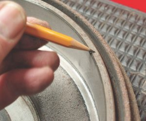 The presence of a chamfer usually indicates whether or not a brake drum can be resurfaced. At the minimum, I recommend a shallow cut to true the surface and remove the inner and outer wear ridges.