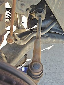 Photo 4: The tie rod should be straight and the outer end at a normal operating angle to the steering knuckle.