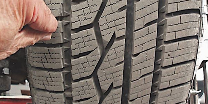 """Photo 1: Due to """"camber roll"""" occurring during sharp turns, unusual tire wear problems will appear on the tire's outside tread bars. This tire is nearly new and is wearing in a normal pattern."""