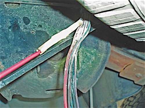 The OE trailer connector used a red wire for brake voltage, so I spliced a red wire into the light-blue brake wire, which terminated above the spare.